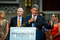 United States Senator Joe Manchin III (Democrat of West Virginia) makes remarks after the vote on the motion to invoke cloture to proceed to the consideration of H.R. 3684, the INVEST in America Act on Capitol Hill in Washington, DC on Wednesday, July 28, 2021. The vote to begin discussion of the bipartisan infrastructure bill agreed to by the White House, was 67 to 32. If passed, the bill would invest close to $1 trillion in roads, bridges, ports and other infrastructure without a major tax increase.<br /> Credit: Rod Lamkey / CNP / MediaPunch