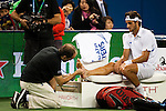 SHANGHAI, CHINA - OCTOBER 17:  Feliciano Lopez of Spain receives treatment from ATP trainer Clay Sniteman before retiring against his compatriot Rafal Nadal on their semi final match during day seven of 2009 Shanghai ATP Masters 1000 at Qi Zhong Tennis Centre on October 17, 2009 in Shanghai, China. Photo by Victor Fraile / The Power of Sport Images