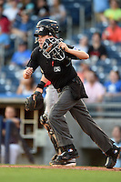 Home plate umpire Matthew Czajak gets in position during the second game of a doubleheader between the Frisco Rough Riders and Tulsa Drillers on May 29, 2014 at ONEOK Field in Tulsa, Oklahoma.  Frisco defeated Tulsa 3-2.  (Mike Janes/Four Seam Images)