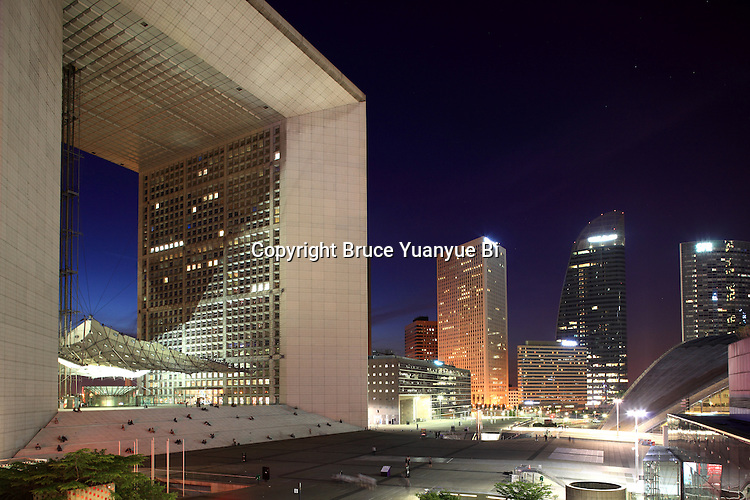 The night view of Grande Arche with high-rise office towers in the background. La Defense. Paris. France