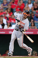 Baltimore Orioles catcher Matt Wieters #32 bats against the Los Angeles Angels at Angel Stadium on August 20, 2011 in Anaheim,California. Los Angeles defeated Baltimore 9-8.(Larry Goren/Four Seam Images)