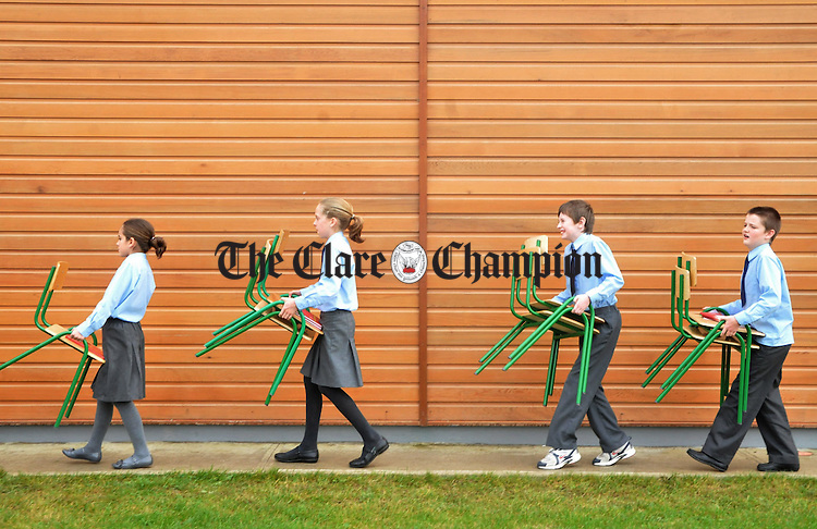 Students at Ballina National School head back to class after the new school's official opening on Friday. Photograph by Declan Monaghan