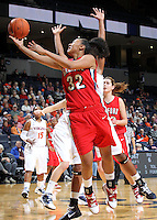 Dec. 6, 2010; Charlottesville, VA, USA; Radford Highlanders forward Kahealani Vick (32) shoots the ball in front of Virginia Cavalier defenders at the John Paul Jones Arena.  Mandatory Credit: Andrew Shurtleff-