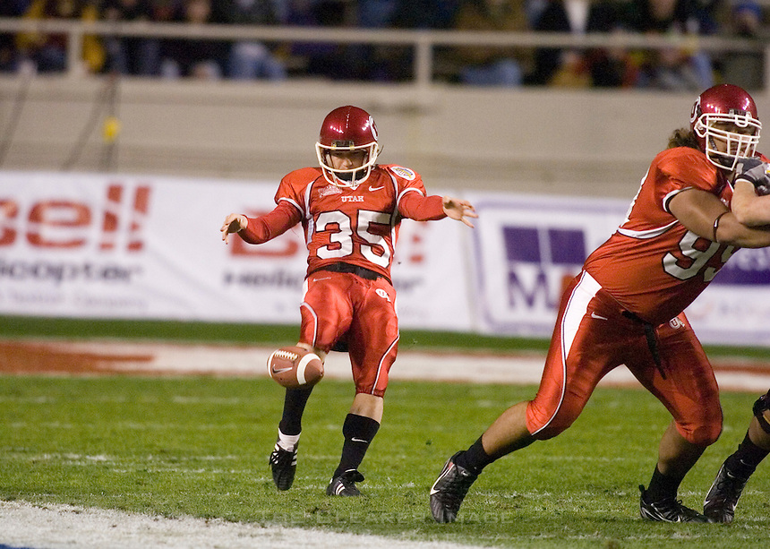 23 December 2006: Utah punter Louie Sakoda kicks the ball during the 2006 Bell Helicopters Armed Forces Bowl between The University of Tulsa and The University of Utah at Amon G. Carter Stadium in Fort Worth, TX.