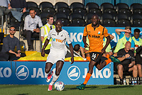 Modou Barrow of Swansea City & Simeon Akinola of Barnet during the 2017/18 Pre Season Friendly match between Barnet and Swansea City at The Hive, London, England on 12 July 2017. Photo by Andy Rowland.