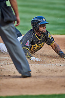 Eric Young Jr. (8) of the Salt Lake Bees slides home during the game against the Sacramento River Cats at Smith's Ballpark on May 17, 2018 in Salt Lake City, Utah. Salt Lake defeated Sacramento 12-11. (Stephen Smith/Four Seam Images)