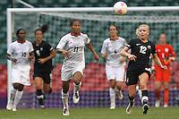 Rachel YANKEY of Great Britain seeks to evade Betsy HASSETT of New Zealand - Great Britain Women vs New Zealand Women - Womens Olympic Football Tournament London 2012 Group E at the Millenium Stadium, Cardiff, Wales - 25/07/12 - MANDATORY CREDIT: Gavin Ellis/SHEKICKS/TGSPHOTO - Self billing applies where appropriate - 0845 094 6026 - contact@tgsphoto.co.uk - NO UNPAID USE.