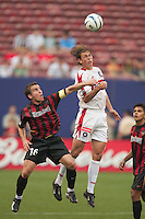Richie Williams and Amado Guevara of the MetroStars can not stop Kelly Grey  on this header. The Chicago Fire defeated the NY/NJ MetroStars 3-2 on 6/14/03 at Giant's Stadium, NJ..