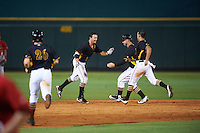 Bradenton Marauders Kevin Kramer (14) starting to get mobbed by teammates, including Wyatt Mathisen (28) and Tomas Morales (27), after a walk off hit during a game against the Palm Beach Cardinals on August 8, 2016 at McKechnie Field in Bradenton, Florida.  Bradenton defeated Palm Beach 5-4.  (Mike Janes/Four Seam Images)