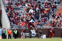 BLACKSBURG, VA - OCTOBER 19: Jermaine Waller #28 of Virginia Tech breaks up a pass attempt to Antoine Green #3 of the University of North Carolina during a game between North Carolina and Virginia Tech at Lane Stadium on October 19, 2019 in Blacksburg, Virginia.