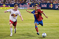 FC Barcelona forward Jeffren Suarez (17) is marked by New York Red Bulls defender Chris Leitch (33). FC Barcelona defeated the New York Red Bulls 6-2 during an international friendly at Giants Stadium in East Rutherford, NJ, on August 6, 2008.