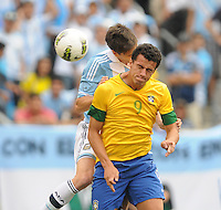 Brazil forward Leandro Damiao (9) heads the ball from Argentina defender Federico Rodriguez (17) The Argentina National Team defeated Brazil 4-3 at MetLife Stadium, Saturday July 9 , 2012.