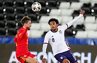SWANSEA, WALES - NOVEMBER 12: Weston McKennie #8 of the United States heads a ball during a game between Wales and USMNT at Liberty Stadium on November 12, 2020 in Swansea, Wales.