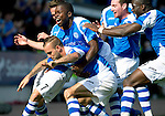 St Johnstone v Celtic....15.09.12      SPL  .Rowan Vine is mobbed by his team mates, Nigel Hasselbaink, Paddy Cregg, Gregory Tade and Chris Millar after scoring his goal that won the match for Saints.Picture by Graeme Hart..Copyright Perthshire Picture Agency.Tel: 01738 623350  Mobile: 07990 594431