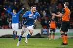 St Johnstone v Dundee United...27.12.14   SPFL<br /> Michael O'Halloran celebrates his goal as Sean Dillon despairs<br /> Picture by Graeme Hart.<br /> Copyright Perthshire Picture Agency<br /> Tel: 01738 623350  Mobile: 07990 594431