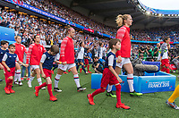 PARIS,  - JUNE 28: Becky Sauerbrunn #4 and Sam Mewis #3 enter the field during a game between France and USWNT at Parc des Princes on June 28, 2019 in Paris, France.