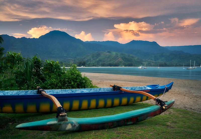 Outrigger canoe on Hanalei Beach, with sunrise. Kauai, Hawaii
