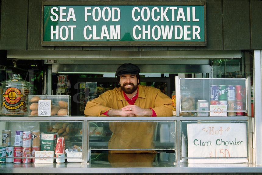 Salesman sells FISH to tourists at FISHERMAN'S WHARF - SAN FRANCISCO, CALIFORNIA.