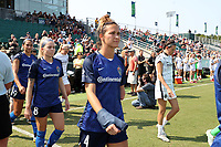 CARY, NC - SEPTEMBER 12: Carson Pickett #4 of the North Carolina Courage enters the field as part of the ceremonial walkout before a game between Portland Thorns FC and North Carolina Courage at Sahlen's Stadium at WakeMed Soccer Park on September 12, 2021 in Cary, North Carolina.