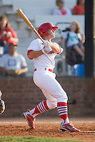 Chris Edmondson #11 of the Johnson City Cardinals follows through on his swing against the Elizabethton Twins at Howard Johnson Field July 3, 2010, in Johnson City, Tennessee.  Photo by Brian Westerholt / Four Seam Images