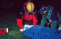 Mountain rescue team attending to an injured walker on the side of a mountain..This image may only be used to portray the subject in a positive manner..©shoutpictures.com..john@shoutpictures.com