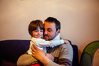 Former refugee Elvis Causevic with his daughter Adna in the family home. <br /> <br /> In 1992 while volunteering at the Varazdin refugee camp Panos photographer Bjoern Steinz met and became close to Elvis, a Bosnian Muslim refugee, and his family. They shared the hardships of camp life together which Steinz documented. While the prints were archived for many years two of the images always returned to Bjoern's thoughts. 25 years later he set out to try and find out what had happened to Elvis and his family in the intervening years. Modern social media made the task surprisingly easy and they were reunited in Hadzici where Elvis now lives with his family.
