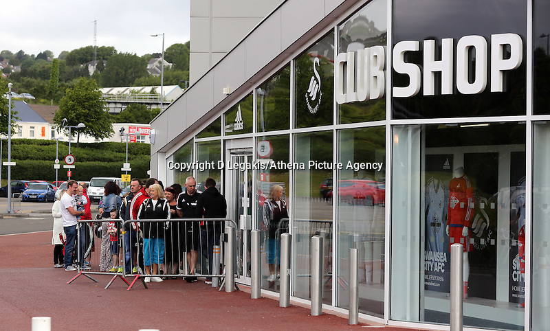 Saturday, 06 June 2015<br /> Pictured: Shoppers queue outside the club shop<br /> Re: Swansea City FC new home kit launch at the club shop of the Liberty Stadium, south Wales, UK.