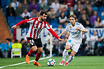 Luka Modric (R) of Real Madrid competes for the ball with Mikel Balenziaga Oruesagasti of Athletic Club de Bilbao during the La Liga 2017-18 match between Real Madrid and Athletic Club Bilbao at Estadio Santiago Bernabeu on April 18 2018 in Madrid, Spain. Photo by Diego Souto / Power Sport Images