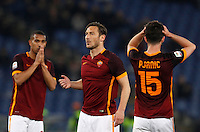 Calcio, Serie A: Roma vs Fiorentina. Roma, stadio Olimpico, 4 marzo 2016.<br /> Roma's Francesco Totti, center, reacts with teammates William Vainqueur, left, and Miralem Pjanic, after missing to score on a free kick during the Italian Serie A football match between Roma and Fiorentina at Rome's Olympic stadium, 4 March 2016.<br /> UPDATE IMAGES PRESS/Riccardo De Luca