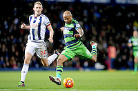Andre Ayew of Swansea City shoots at goal as Darren Fletcher of West Bromwich Albion looks on during the Barclays Premier League match between West Bromwich Albion and Swansea City at The Hawthorns on the 2nd of February 2016