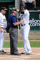 Worcester Tornadoes Designated Hitter Jose Canseco #13 states his case to the first base umpire after being ejected by the home plate umpire during a game versus the New Jersey Jackals at Fitton Field in Worcester, Massachusetts on June 3, 2012.  (Ken Babbitt/Four Seam Images)