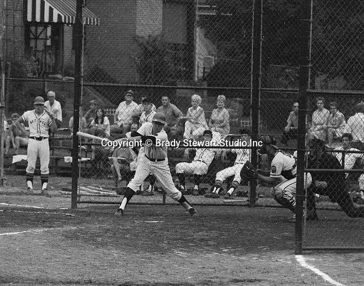 Ford City PA:  Bethel Park vs Arnold to advance to the state American Legion Playoffs.  Bob Purkey Jr swinging and missing during the game.  Bob Purkey pitched a shut out (1-0) and the team advanced to the state playoffs in Allentown PA. Others in the photo; Mr. and Mrs. Bob Purkey Sr, Mike Stewart, Paul Hauck, Gary Biro, Craig Balmford, and Bob Colligan