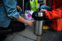 "London, 11/05/2016. This evening, members of the public supported by Zekra, the organiser of ""Happy Ravers"", walked from Victoria Station to Leicester Square in Central London for ""distributing and collecting essential items to those who may need them on our streets"". Cups of tea, coffee and hot soups, sandwiches, muffins, water, biscuits and a lot of smiles, company and hugs were donated this evening to the homeless people who are living in some London's streets and sleeping rough. <br /> <br /> For more information and to help please click here: https://www.facebook.com/groups/havers/"