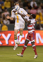 LA Galaxy FWD Nate Jaqua goes high for a ball over FC Dallas DEF Chris Gbandi during a MLS match. FC Dallas beat LA Galaxy 2-1 at the Home Depot Center in Carson, California, Thursday April 12, 2007.