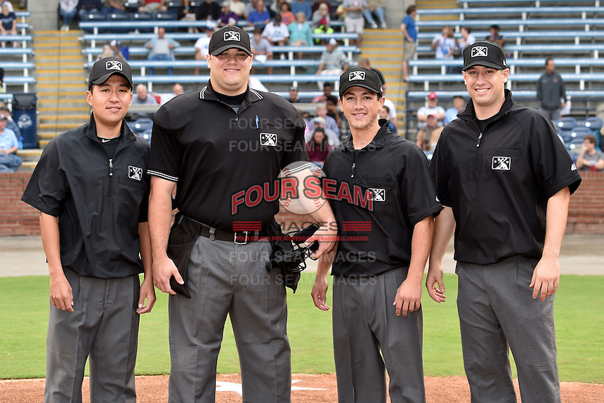 South Atlantic League umpiring crew (L-R) first base umpire Takahito Matsuda, home plate umpire Tucker Benneville, second base umpire Derek Gonzales, third base umpire Jonathan Felczak before a game between the Hagerstown Sun and the Asheville Tourists at McCormick Field on September 8, 2014 in Asheville, North Carolina. The Tourists defeated the Suns 16-7. (Tony Farlow/Four Seam Images)