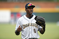 Center fielder Estevan Florial (8) of the Charleston RiverDogs warms up before a game against the Greenville Drive on Friday, July 28, 2017, at Fluor Field at the West End in Greenville, South Carolina. Charleston won, 6-1. (Tom Priddy/Four Seam Images)