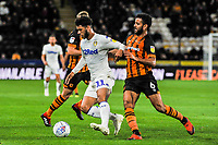 Leeds United's forward Tyler Roberts (11) holds off Hull City's midfielder Kevin Stewart (6) during the Sky Bet Championship match between Hull City and Leeds United at the KC Stadium, Kingston upon Hull, England on 2 October 2018. Photo by Stephen Buckley/PRiME Media Images.