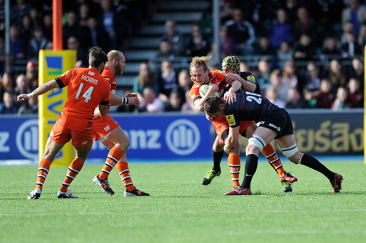 Sam Harrison of Leicester Tigers is tackled by Ernst Joubert of Saracens during the Aviva Premiership Rugby match between Saracens and Leicester Tigers at Allianz Park on Saturday 11th April 2015 (Photo by Rob Munro)