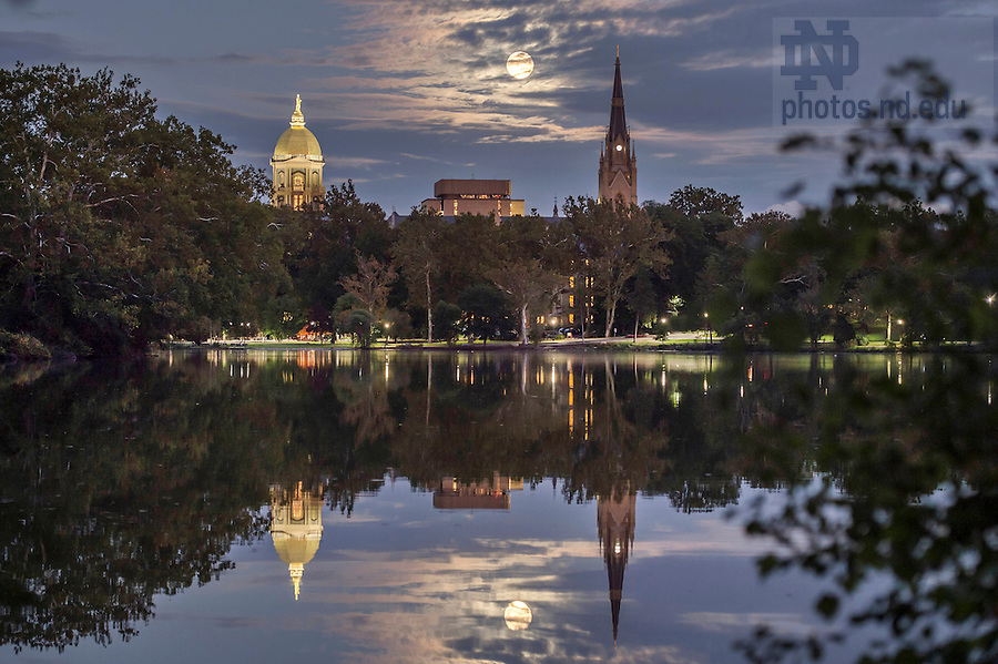 Sept. 27, 2015; Supermoon rises between the Golden Dome and the steeple of the Basilica of the Sacred Heart. (Photo by Barbara Johnston/University of Notre Dame)