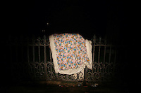 CHINA. Beijing. A bed cover hanging on a fence in Gongzhufen . 2008