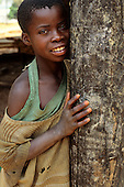 Yumba Bay, Tanzania. Unsure serious child in evening light.