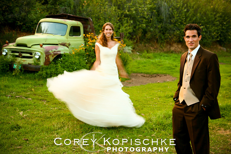 Bride and groom formals by a rustic truck in Northern Colorado.