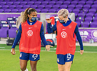 ORLANDO, FL - JANUARY 22: Catarina Macario #29 and Megan Rapinoe #15 of the USWNT celebrate after a game between Colombia and USWNT at Exploria stadium on January 22, 2021 in Orlando, Florida.