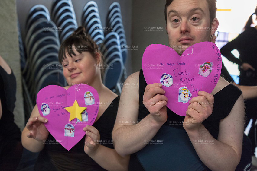 Switzerland. Canton Ticino. Orselina. Clinica Santa Croce. MOPS_DanceSyndrome is an independent Swiss artistic, cultural and social organisation operating in the field of contemporary dance and disability. It is composed only of Down dancers. Amedeo Aloisi (L) and Simone Lunardi (R) have both received a Christmas card with purples hearts shaped. Merry Christmas and snowmen drawings. Down syndrome (DS or DNS), also known as trisomy 21, is a genetic disorder caused by the presence of all or part of a third copy of chromosome 21 It is usually associated with physical growth delays, mild to moderate intellectual disability, and characteristic facial features. 5.12.2019 © 2019 Didier Ruef
