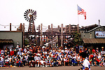 The Fourth of July Parade in Cayucos Beach, California turns the tiny town into the biggest city on the Central Coast for one day every year.  Spectators gather well before the parade begins.