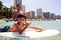 Local boy enjoying a surfing session on a sunny day in Waikiki
