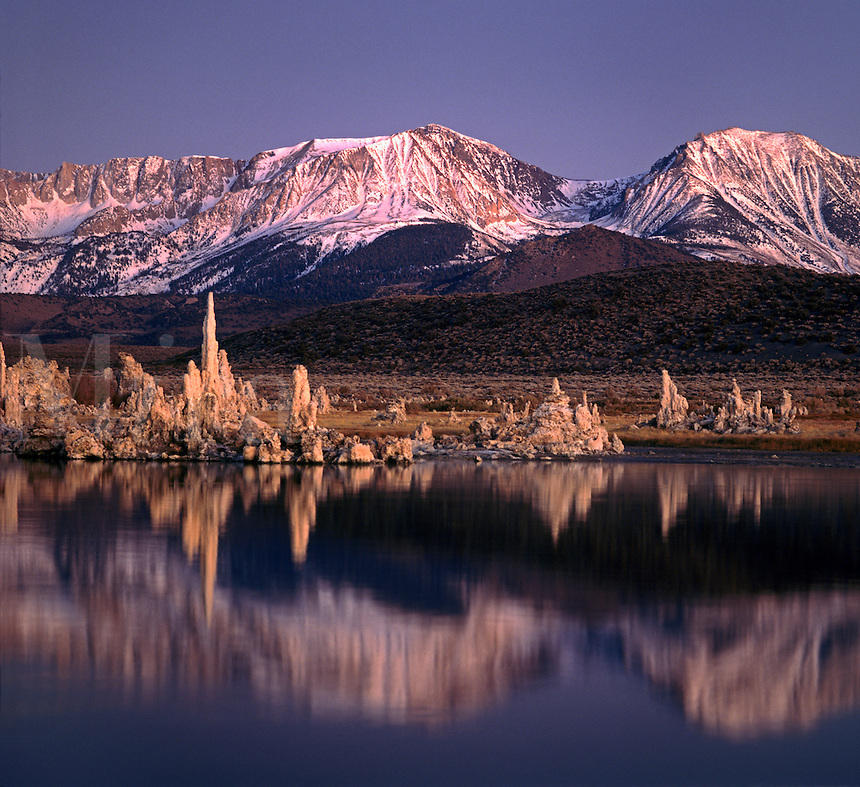 TUFA FORMATIONS rise from the waters of MONO LAKE near the SIERRA NEVADA MOUNTAINS - EASTERN SIERRA, CALIFORNIA