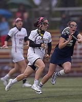 Boston College midfielder Kristin Igoe (21) on the attack. Boston College defeated University of New Hampshire, 11-6, at Newton Campus Field, May 1, 2012.