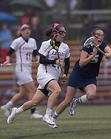 Boston College midfielder Kristin Igoe (21) on the attack. Boston College defeated University of New Hampshire, 11-6, at Newton Campus Field, May 1, 2012.