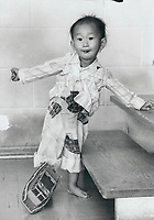 1979 FILE PHOTO - ARCHIVES -<br /> <br /> Vietnam War - Refugees in Canada Quach Sen; 2; shows toy boat<br /> <br /> Bezant, Graham<br /> Picture, 1979,<br /> <br /> 1979,<br /> <br /> PHOTO : Graham Bezant - Toronto Star Archives - AQP